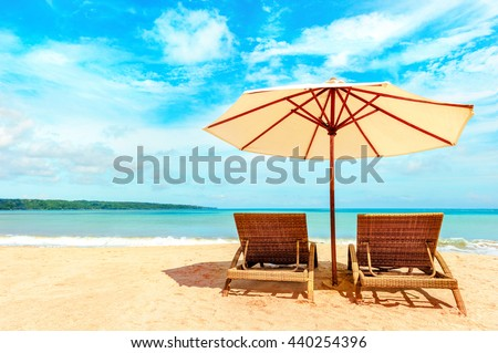 Beautiful Hawaii beach. Chairs on the  sandy beach near the sea. Summer holiday and vacation concept.