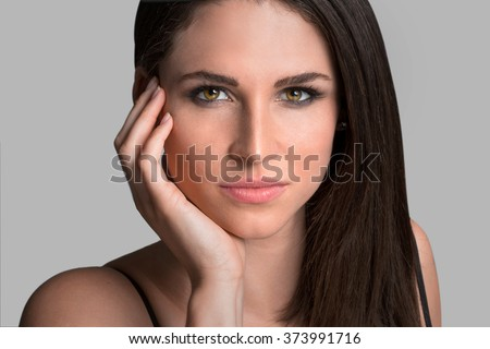 Beautiful headshot of brunette model gorgeous eyes determined stare confident elegant sophisticated woman in thought - stock photo