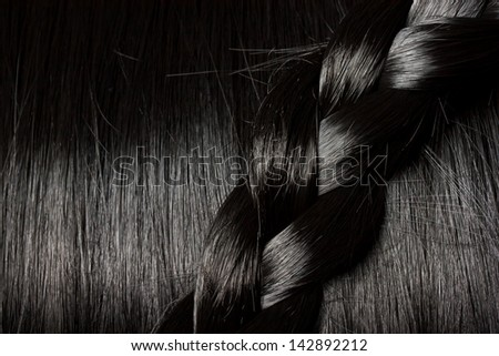 Beautiful healthy black hair with a braid - stock photo