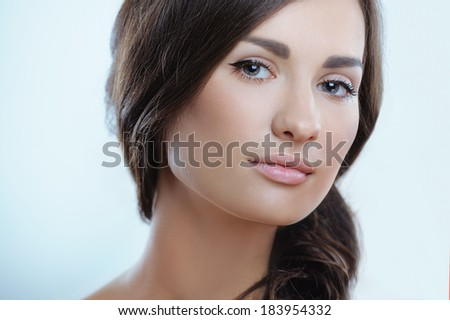 Beautiful healthy girl with clean pure skin and natural makeup - stock photo
