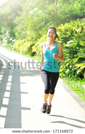 beautiful healthy lifestyle young asian woman jogging in park