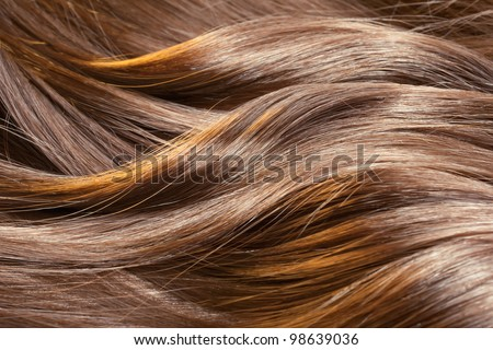 Beautiful healthy shiny hair texture with highlighted golden streaks - stock photo
