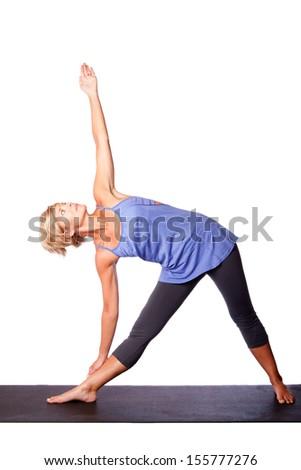 Beautiful healthy woman doing triangle utthita trikonasana yoga pose