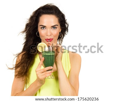 Beautiful healthy woman drinking an organic green smoothie. Isolated on white. - stock photo