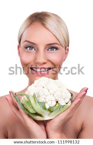 Beautiful healthy woman showing whole cauliflower, healthy food - stock photo