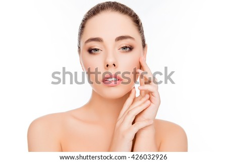 Beautiful healthy woman touching her smooth skin - stock photo