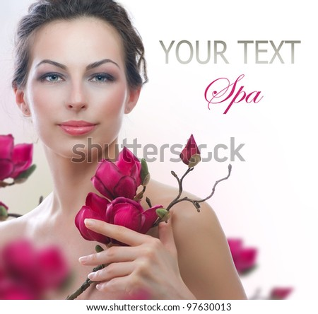 Beautiful Healthy Woman with Spring Flowers.Isolated on White. Spa - stock photo