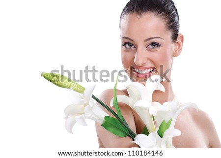 Beautiful healthy young woman holding flower - stock photo