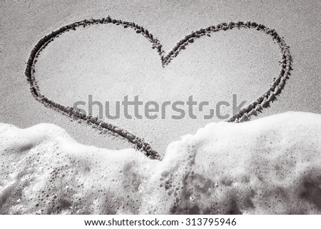 Beautiful heart in the sand.  - stock photo