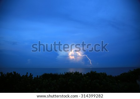 Beautiful heat lightning on a summer night over the Atlantic Ocean - stock photo