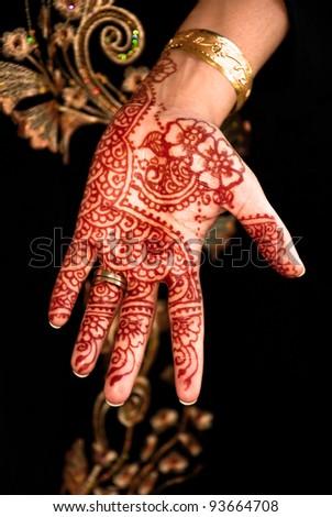 Beautiful henna tattoo in a bride's hand 04 - body art - stock photo