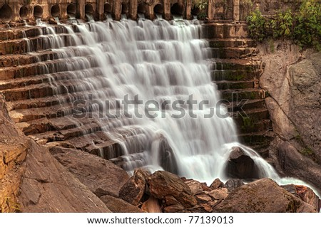 Beautiful high dynamic image of a cascading waterfall at the inlet of a dam