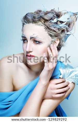 beautiful high fashion female model with fantasy hair style and art make up nature concept - stock photo