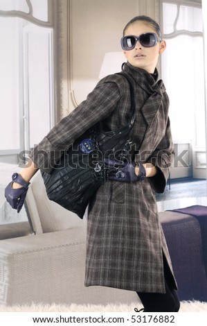 Beautiful high fashion model in autumn clothes posing - stock photo
