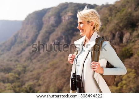 beautiful hiker enjoying the view from top of a mountain - stock photo