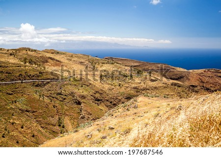Beautiful hiking mountains landscape blue sky clouds and ocean, Canary Islands La Gomera, Spain - stock photo