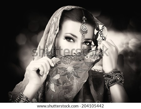 Beautiful hindu woman with traditional clothes, jewelry and makeup. Portrait in black and white - stock photo