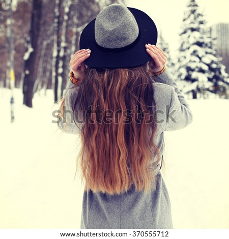 beautiful hipster girl in winter hat. photo toned style instagram flters  - stock photo