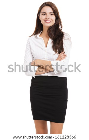 Beautiful hispanic business woman smiling with hands folded, over a white background - stock photo