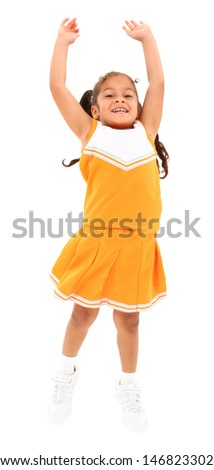 Beautiful hispanic cheer leader in uniform jumping over white background with clipping path. - stock photo