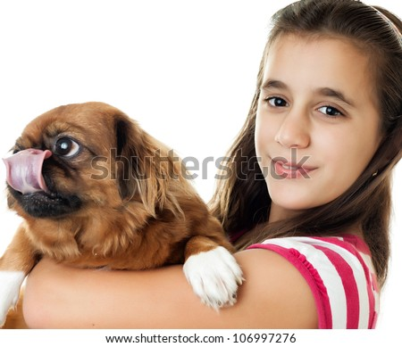 Beautiful hispanic girl carrying her pet pekingese dog isolated on white