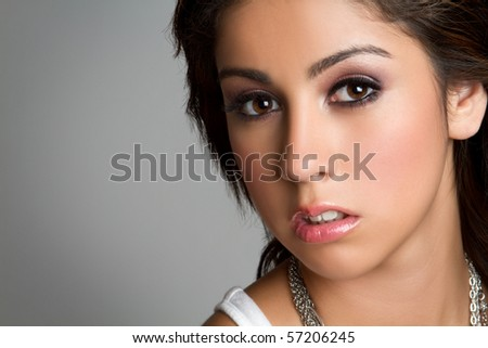 Beautiful hispanic girl headshot closeup - stock photo