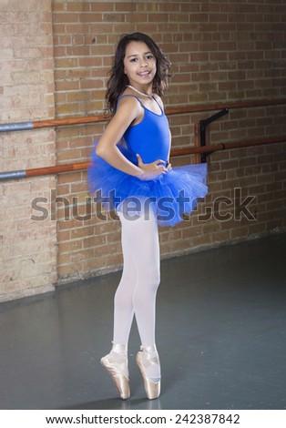 Beautiful Hispanic Teenage ballerina dancer full length - stock photo