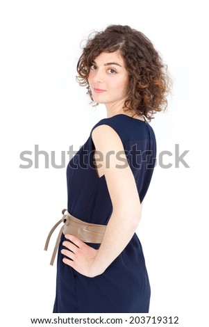 Beautiful Hispanic woman doing different expressions in different sets of clothes: posing - stock photo