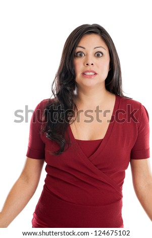Beautiful Hispanic woman with shocked expression isolated on a white background