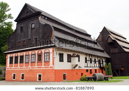 Beautiful historic log house during the daytime. - stock photo