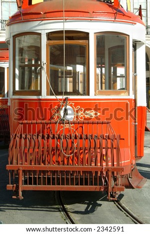 Beautiful historic red streetcar in Lisbon - stock photo