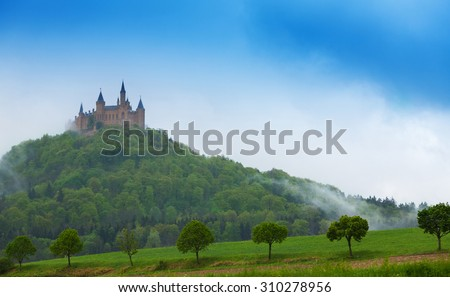 Beautiful Hohenzollern castle in haze during summer time in Germany - stock photo