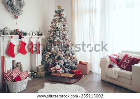 Beautiful holdiay decorated room with Christmas tree with presents under it - stock photo