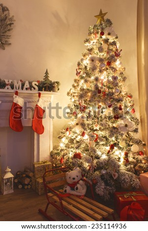 Beautiful holiday decorated room with Christmas tree with presents under it - stock photo