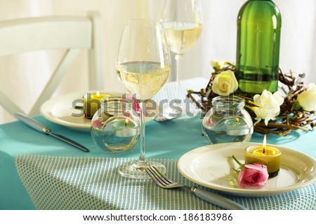 Beautiful holiday Easter table setting in blue tones, on light background  - stock photo