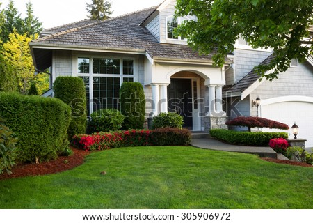 Beautiful home and lawn.  - stock photo