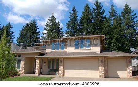 Beautiful Home in Suburban Neighborhood on Sunny Day - stock photo