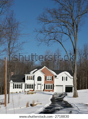 beautiful home in winter - stock photo