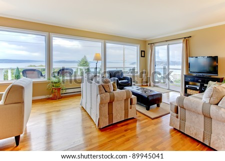 Beautiful home interior with Tv and many windows. - stock photo