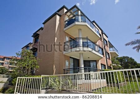 beautiful house against vibrant blue sky - stock photo