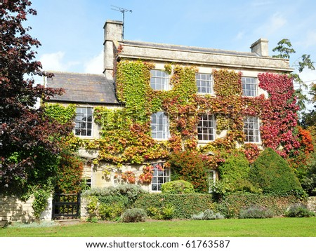 Beautiful House and Garden in Autumn - stock photo