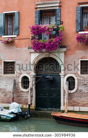 Beautiful house on a canal in Venice - stock photo