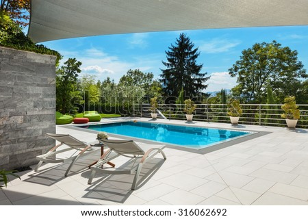 beautiful house, swimming pool view from the veranda, summer day - stock photo