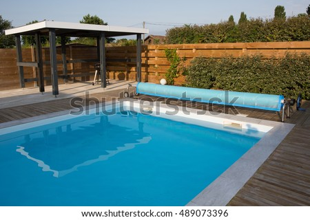 beautiful house, swimming pool view summer day