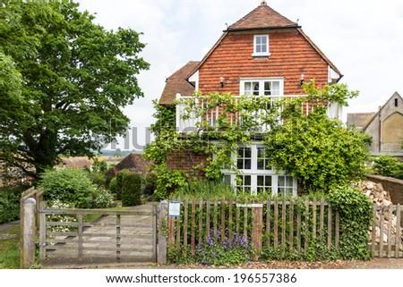 Beautiful house with green garden seen in Rye, Kent, UK. - stock photo