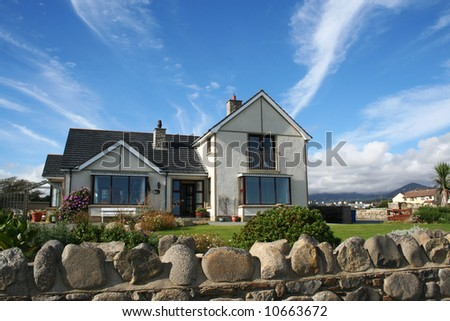 Beautiful house with the garden - stock photo
