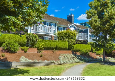 Beautiful houses with park pathway in front. British Columbia, Canada. - stock photo
