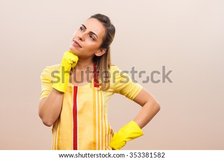 Beautiful housewife is thinking about something beautiful.Housewife thinking - stock photo
