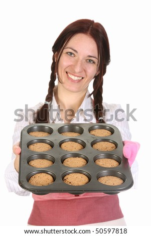 beautiful housewife showing off cakes on white background