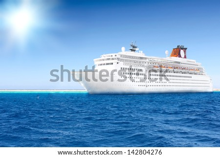 Beautiful huge cruise ship in the sea. Sun at the sky. - stock photo